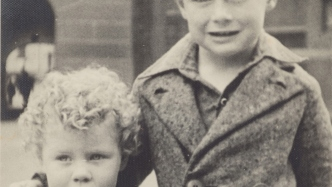 Close crop of two children's faces.