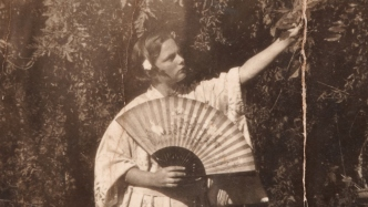 Bobby Paton (nee Terry) in fancy dress, holding a Japanese fan