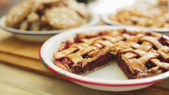 Close view of pies on checked cloth.