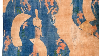 Blue and tan patterned piece of cloth.