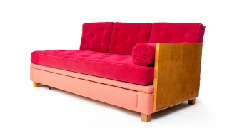 Red upholstered couch bed.