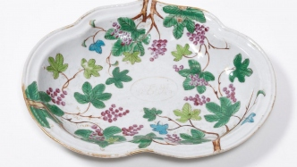 Dish with enamelled decoration of purple grapes and green grape leaves surrounding a cartouche with the monogram of John and Elizabeth Macarthur.