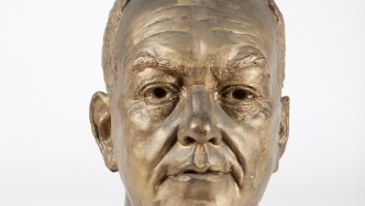 Cropped image of bust.