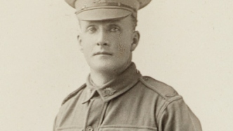 Black and white photo of young man in uniform.