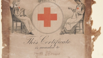 Frayed at edges, certificate with red cross symbol in ornate diagram at top, and cursive script below.