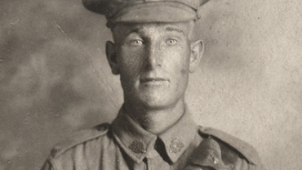 Head and shoulders of young soldier.