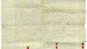 Document on paper with red markings.