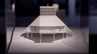 This is a detail photograph of a white architectural model of a house