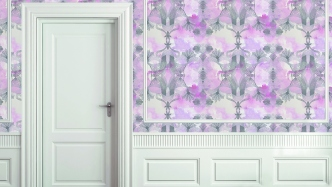 Interior of room with pink patterned wallpaper and a white door.