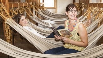 two girls enjoy the hammocks at Hyde Park barracks Museum