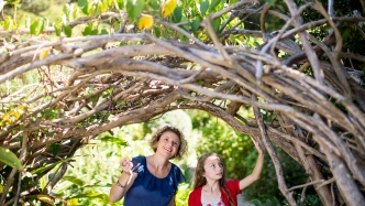 Mother and daughter explore the garden at Vaucluse House