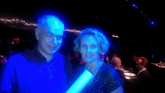 PhilipThalis and Caroline Butler-Bowdon stand side by side. the image has a blue hue.