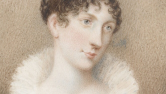 Portrait of Elizabeth Macquarie wearing large white frilled collar and black dress. She is looking slightly sideways and has short curly reddish hair.