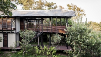 This is a photograph of the belvedere of the Mooloomba House with a native garden surrounding it