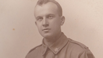 Closeup of man in uniform.