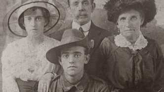 Cropped view of family group.