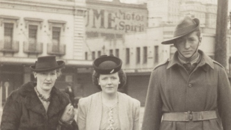 Thumbnail image of three people in street.