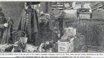 Newspaper clipping of photograph of police with belongings.