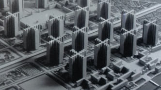 Black and white photograph of model cityscape.