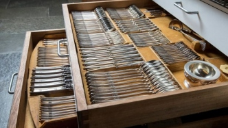 Double layered cutlery drawer pulled out to show cutlery.