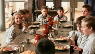 Children enjoying a convict meal