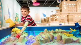 Boy playing with a digital sandbox