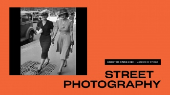 Promo banner with street photo in black and white.