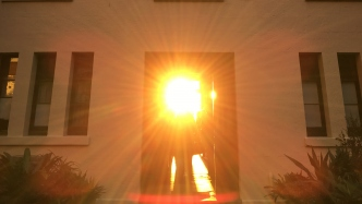 Sun shining through front door and down through hall to rear of house.