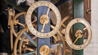 Series of brass cogs and wheels.