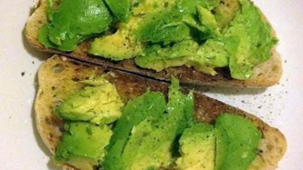 Close up of avocado on toast.