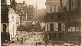 Sepia photograph of demolished buildings in Sydney during the 1930s.