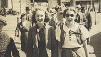 Cropped image of street photo shot of two young women.