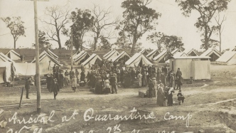 Newspaper photo of tents and people.