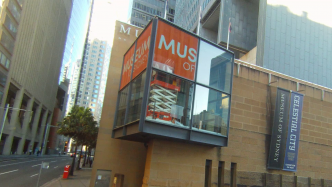 Still from video showing Museum of Sydney viewing cube with new signage being installed.