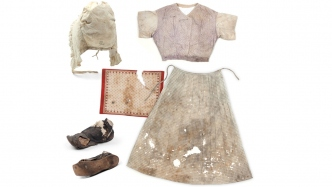 Shoes, handkerchief, cap (stamped with HPA, for Hyde Park Asylum, and broad arrow), bodice and apron worn by asylum inmates.