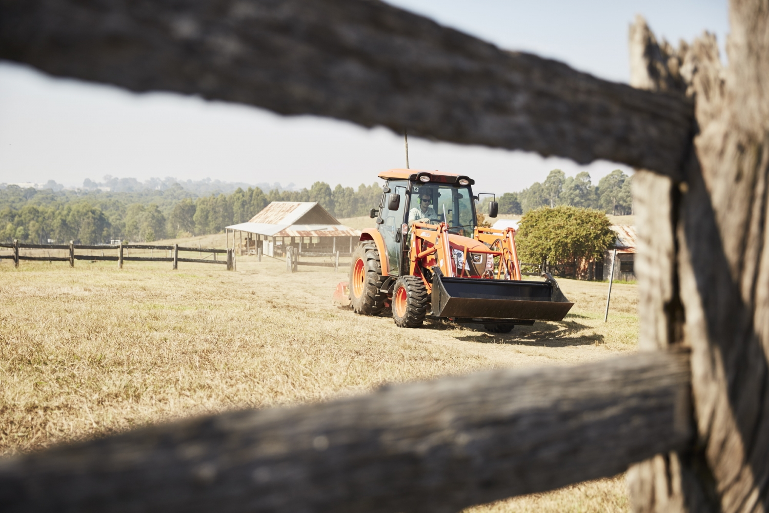 Tractor slashing a paddock at Rouse Hill House and Farm