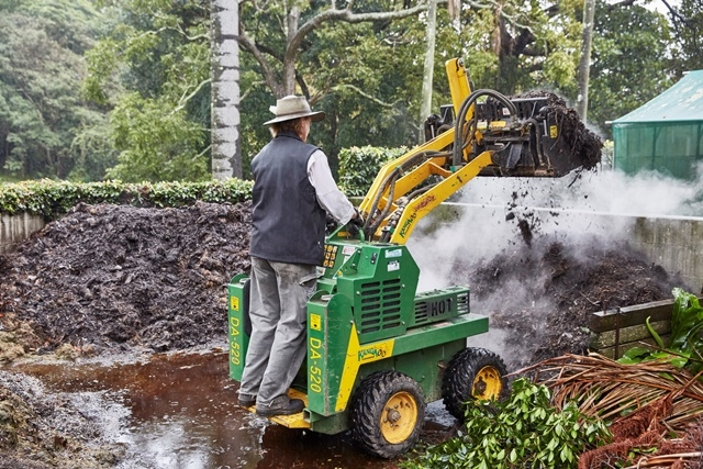 Photograph of a horticulturist moving compost at Vaucluse House gardens