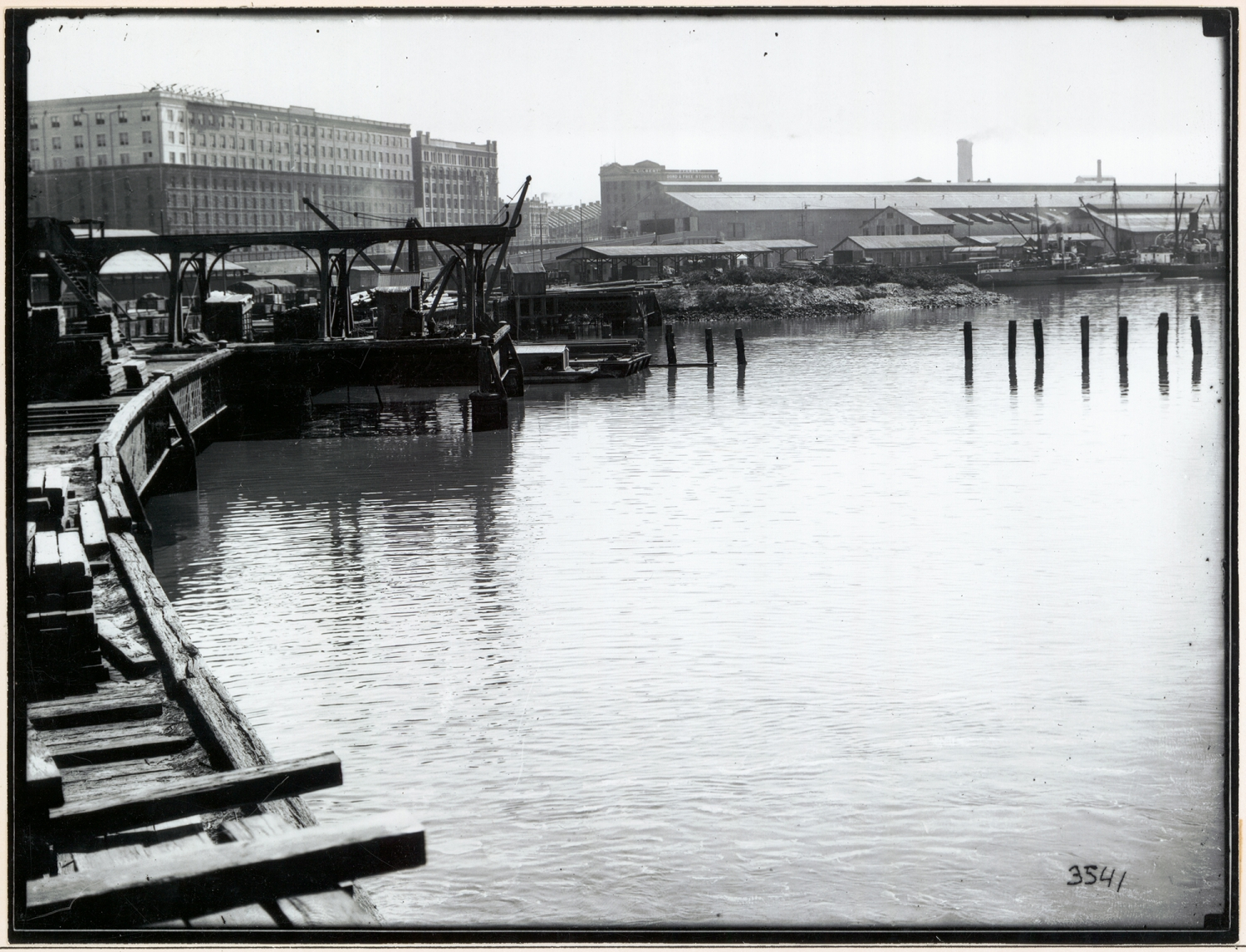 Black and white photograph with water in foreground.