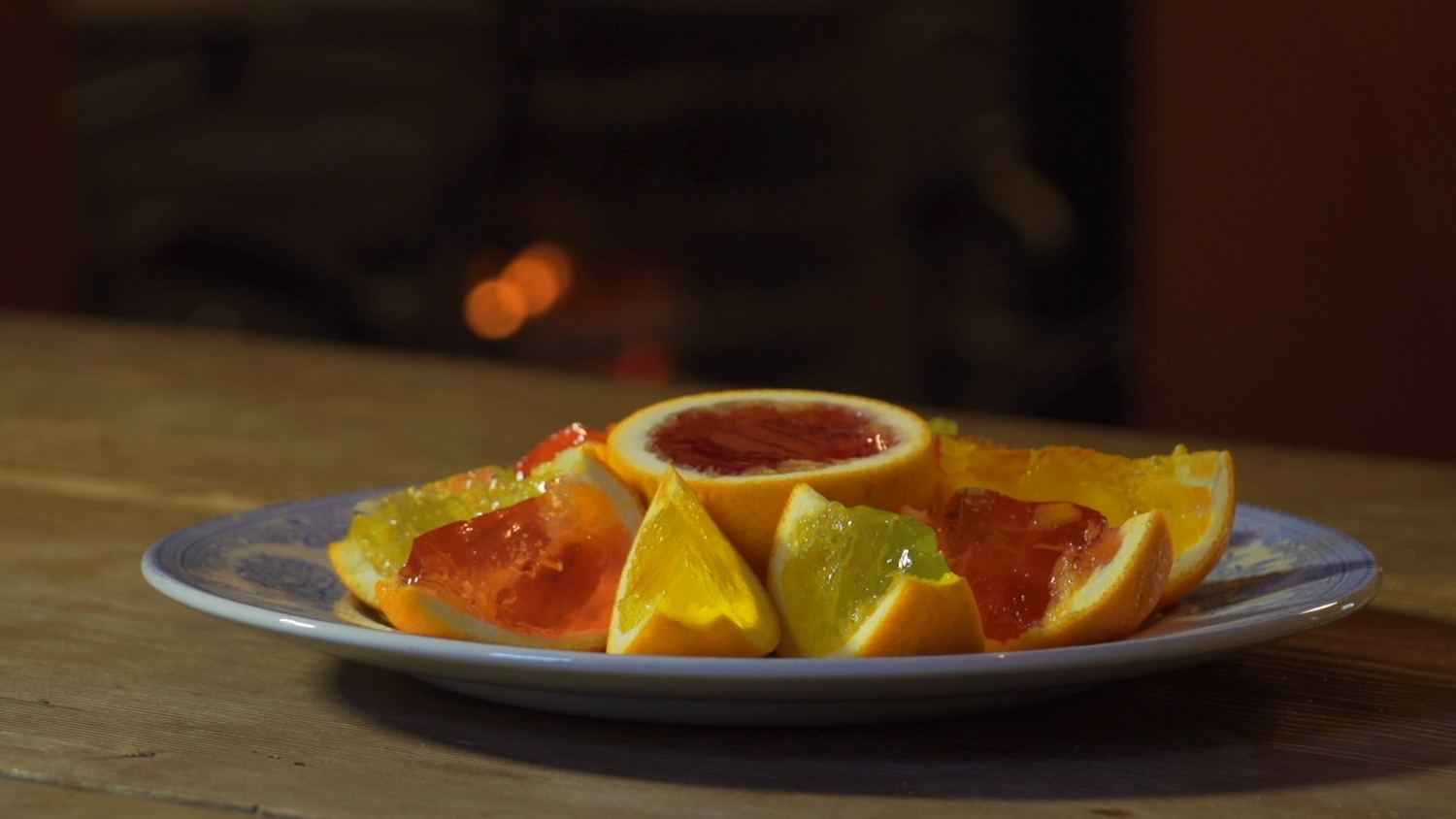 A platter of finished jellies set in cut-up oranges.
