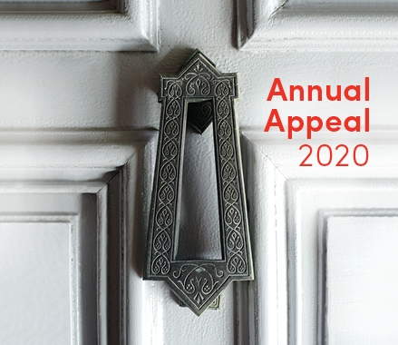 Door knocker with text overlay.