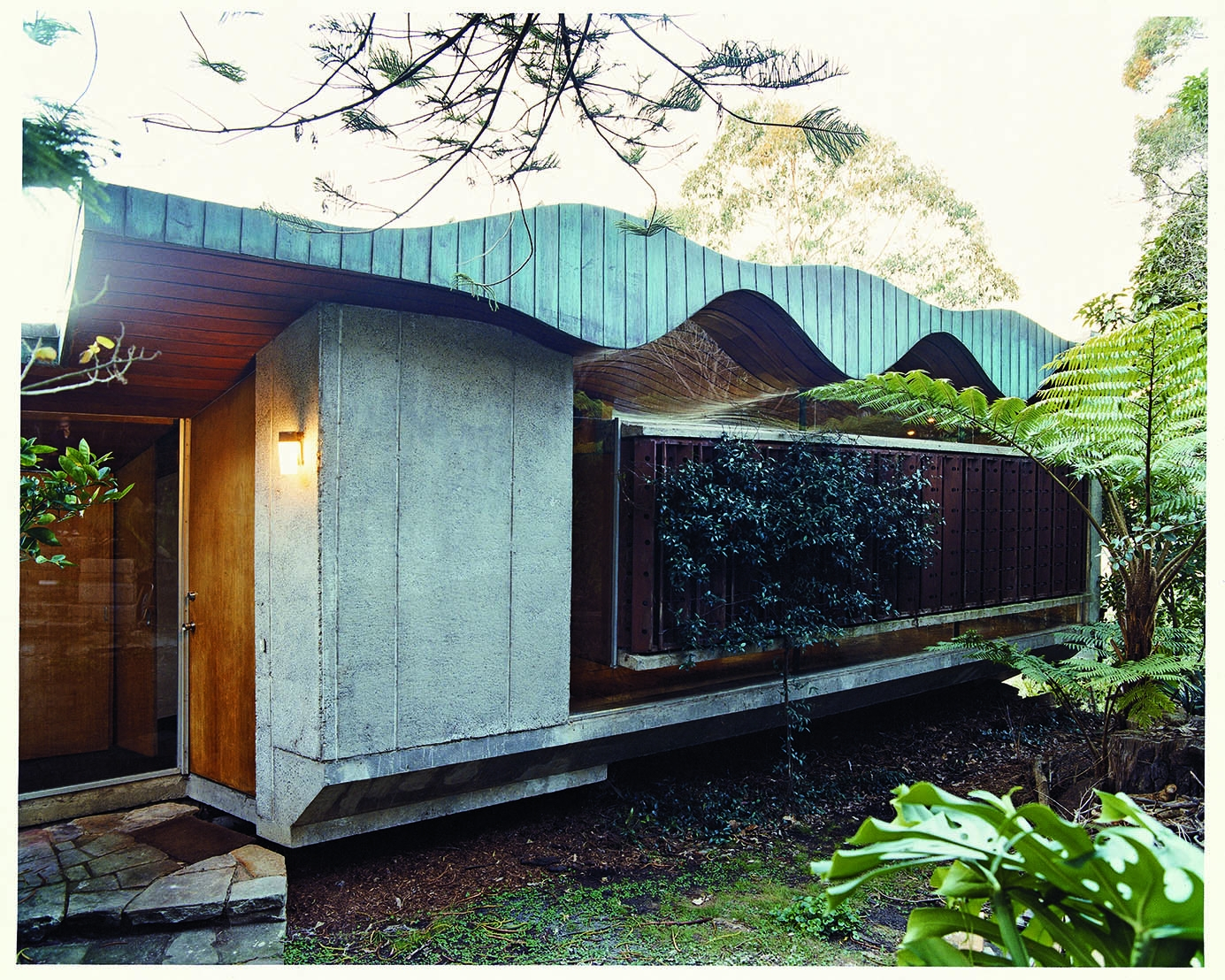 Exterior of Buhrich house showing distinctive curved roof