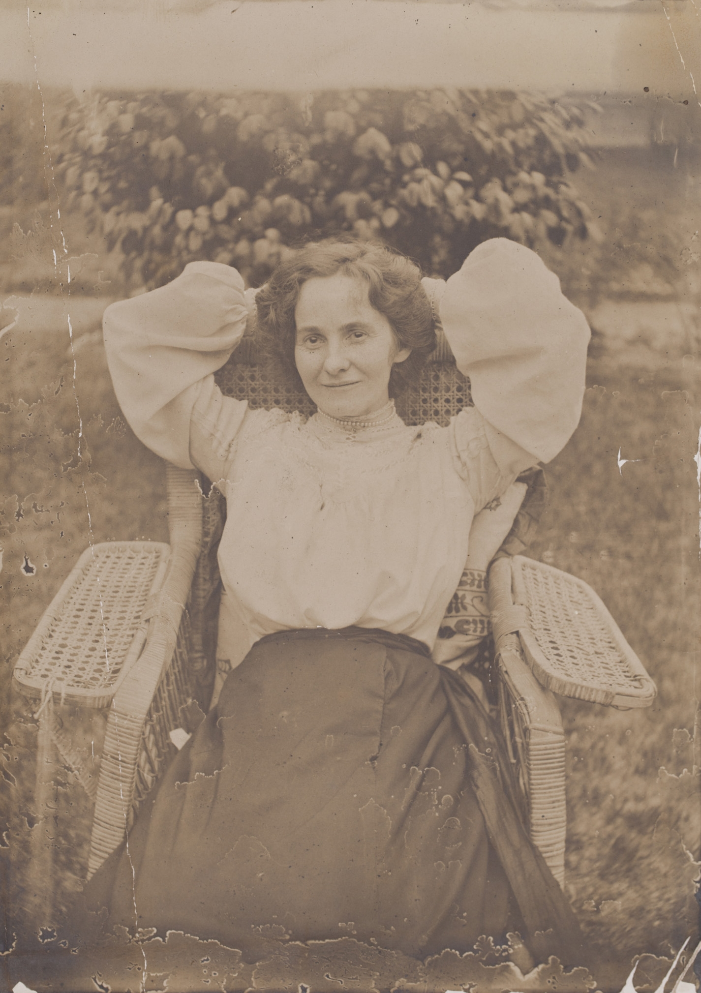Woman reclining in chair.