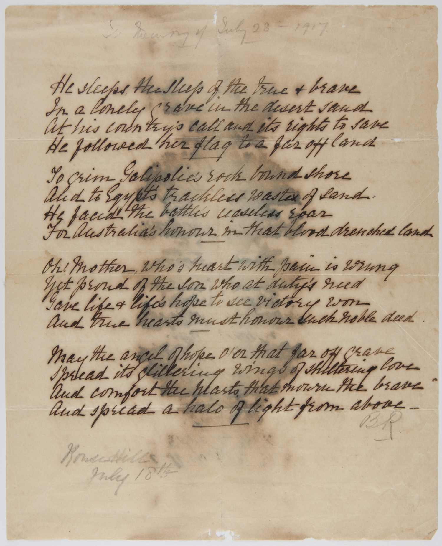 Handwritten poem on paper that has been marked by water.