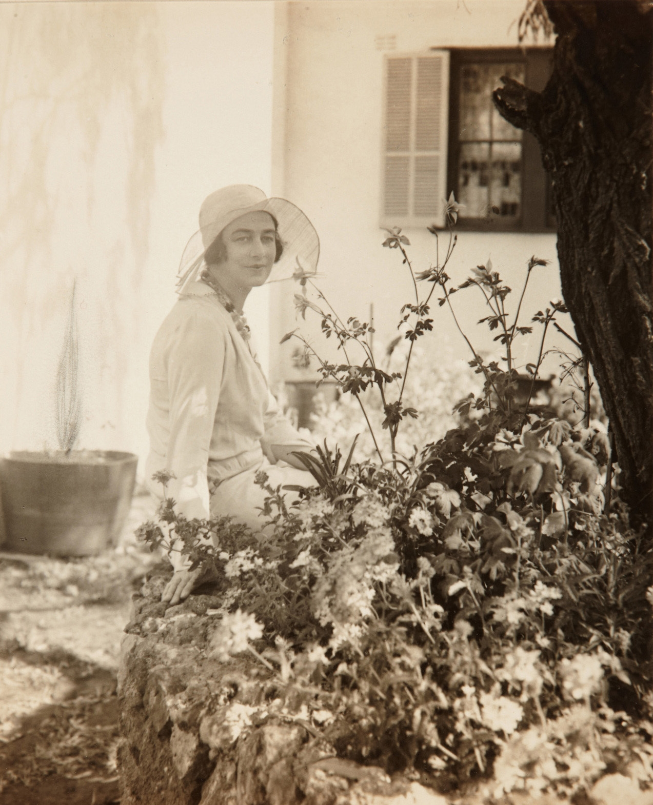 Mrs Muriel Mackay in the garden at Tinagroo homestead near Scone New South Wales, c1925