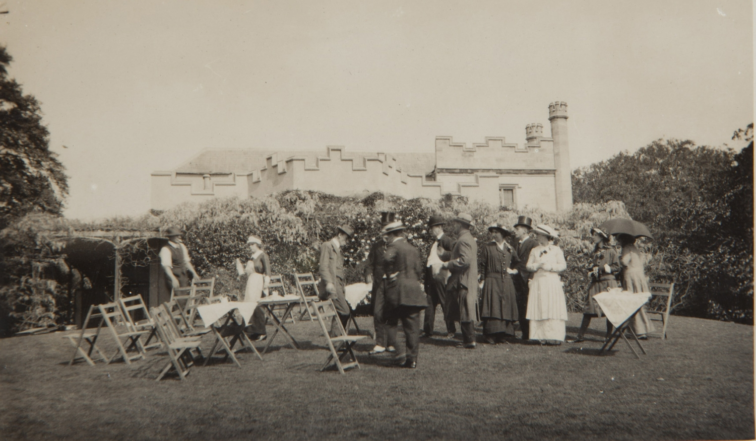 Black and white photograph of guests being served tea on the Vaucluse House lawn