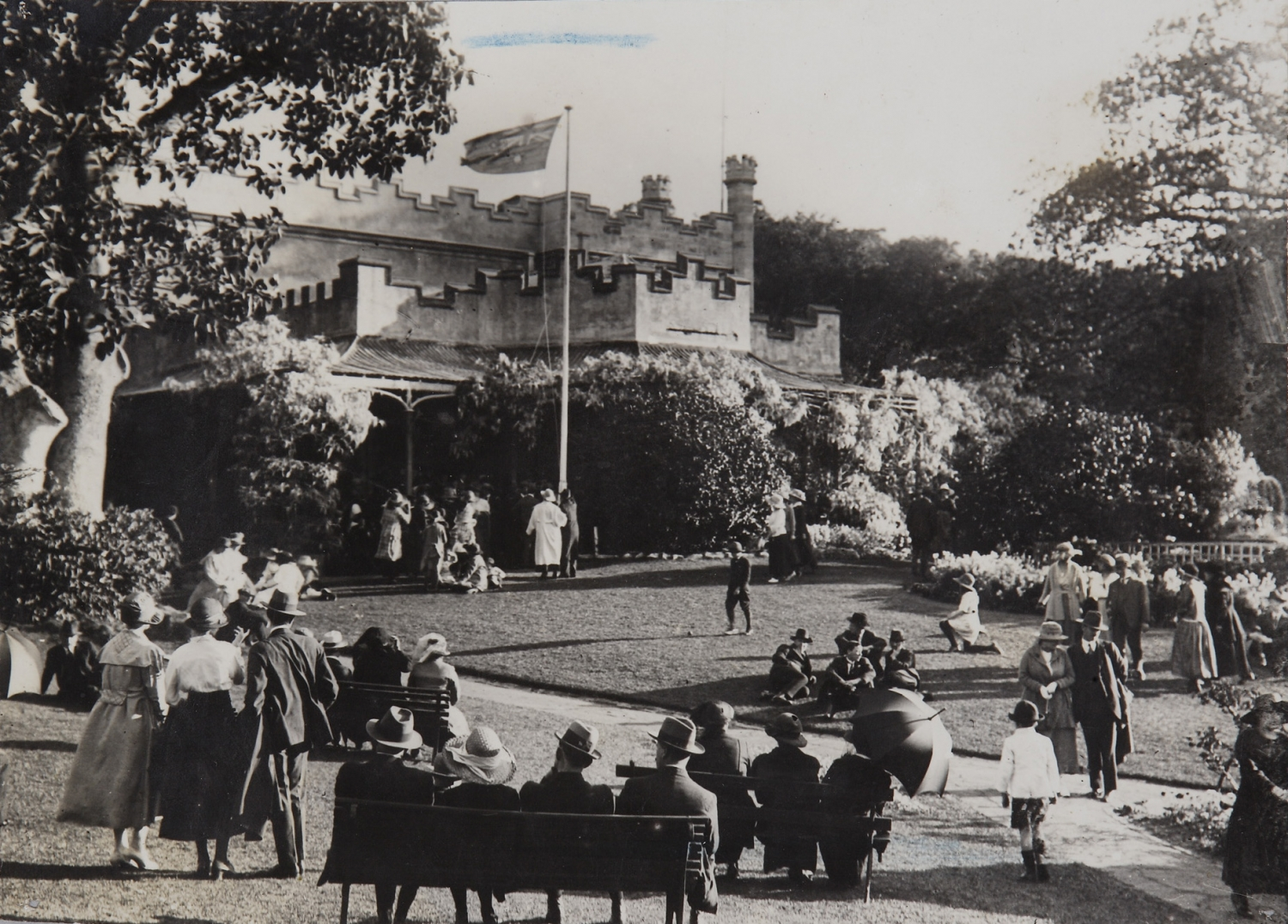 Black and white photograph of crowds at Vaucluse House during wisteria season