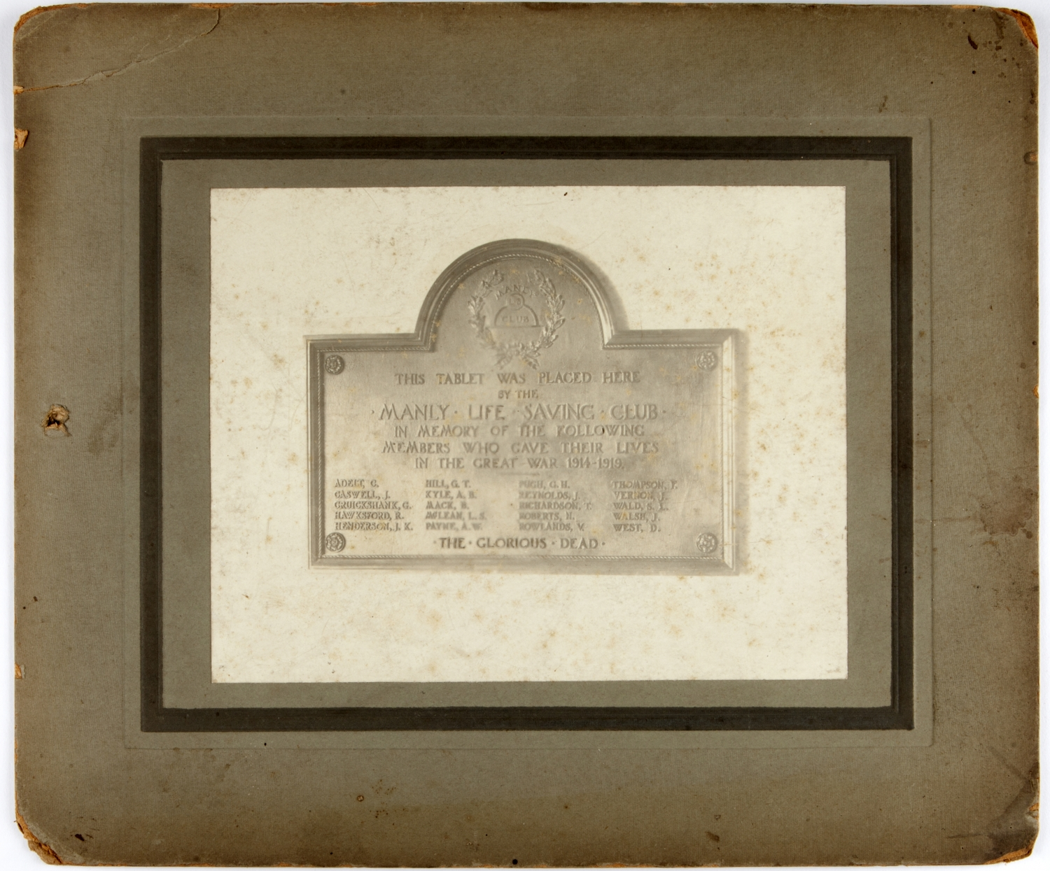 Photo in frame of memorial on wall.