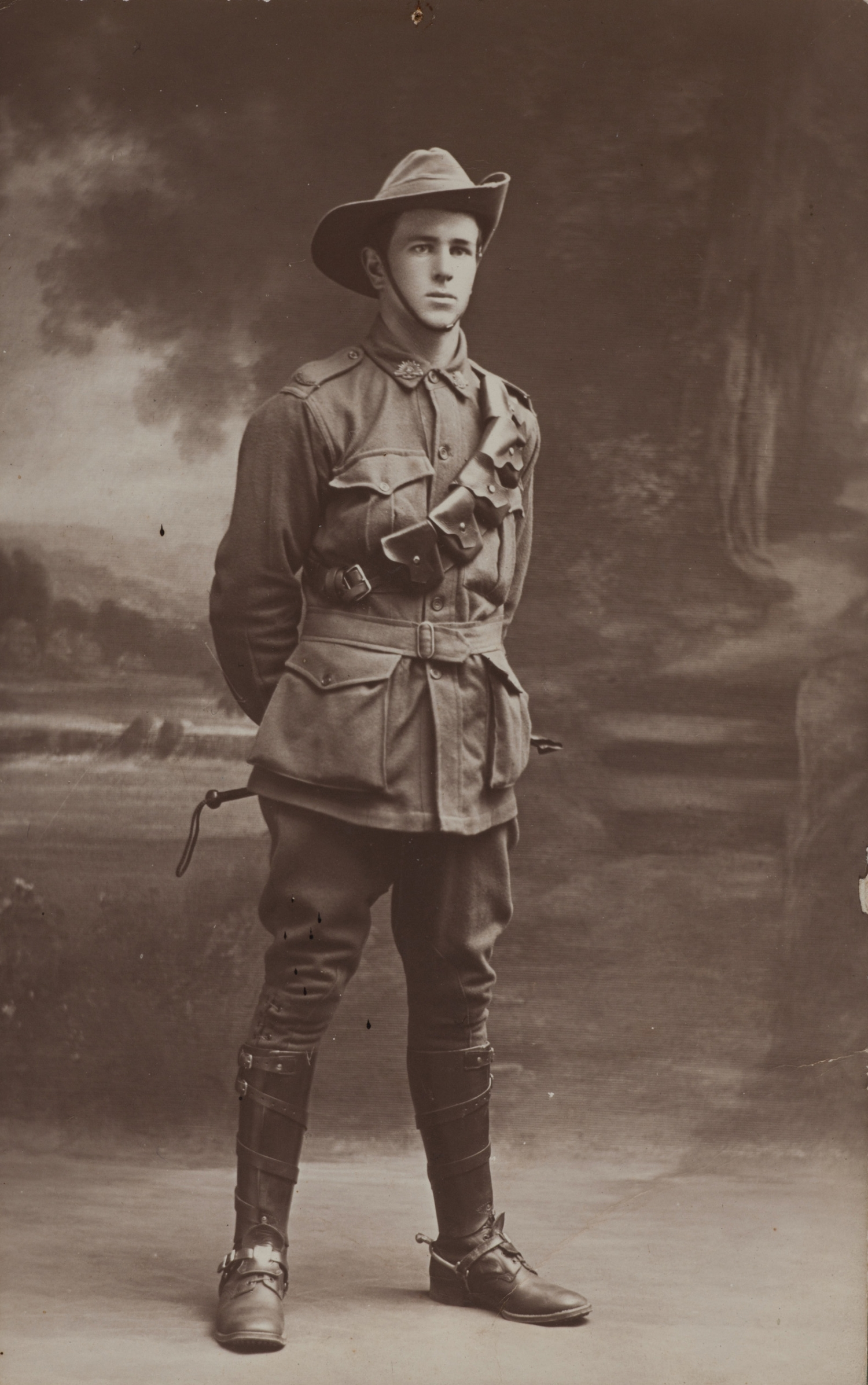 Black and white full length portrait of young man in uniform.