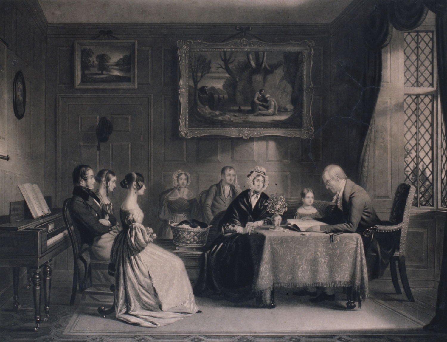 A group of people are seated around a table with a man leading prayers and reading from what appears to be a bible. The room is well furnished with elaborate paintings, furniture and a large window on the left.