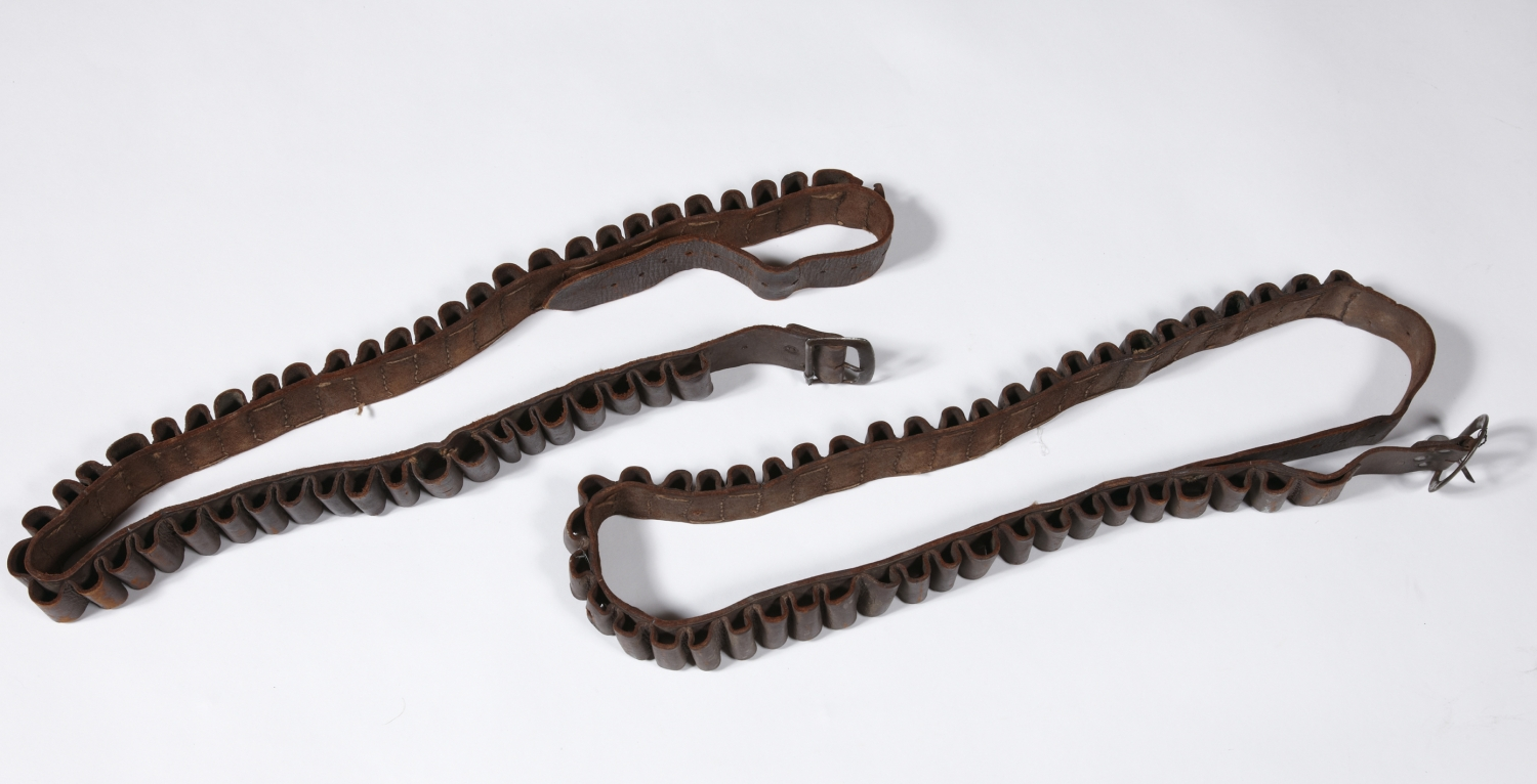 Two leather belts with slots for bullets.